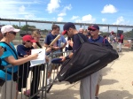 Mauer signs autographs