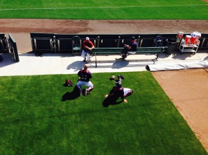Catchers stretch before game