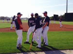 Byron Buxton (No. 70) chats with his teammates